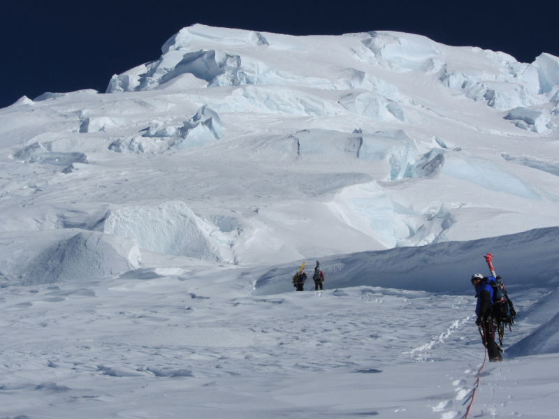 Ski mountaineers in big terrain