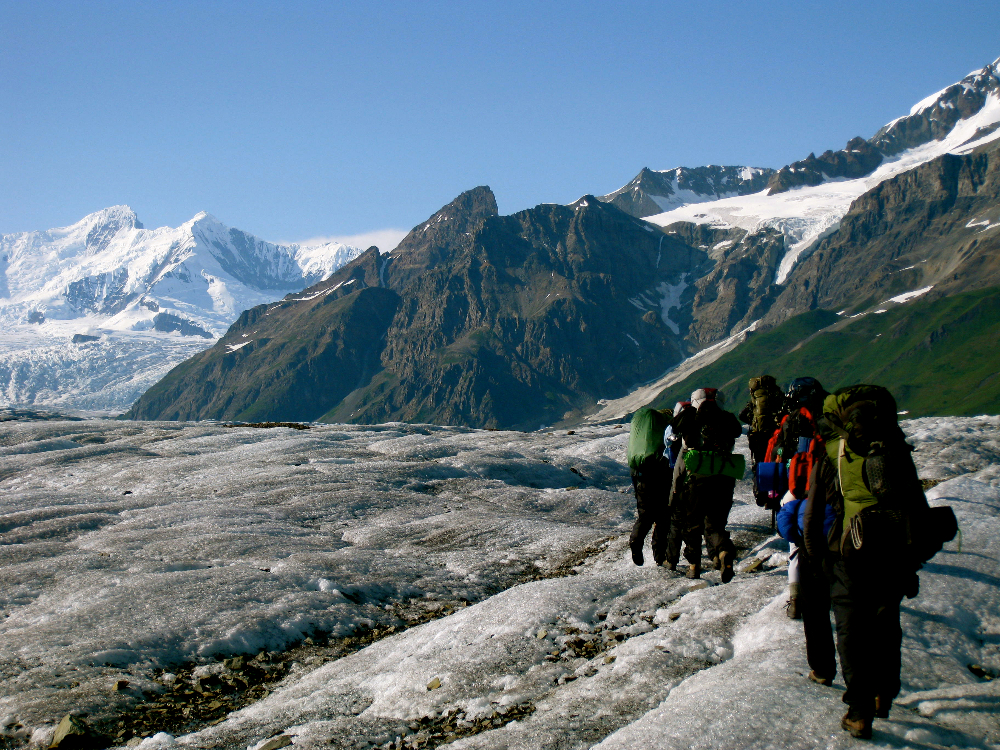 Backpackers on glacier