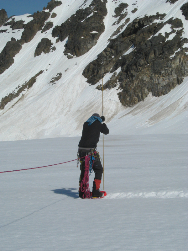 Probing for crevasses at camp
