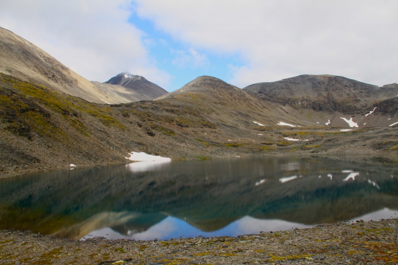 Alaska backpacking past alpine lake