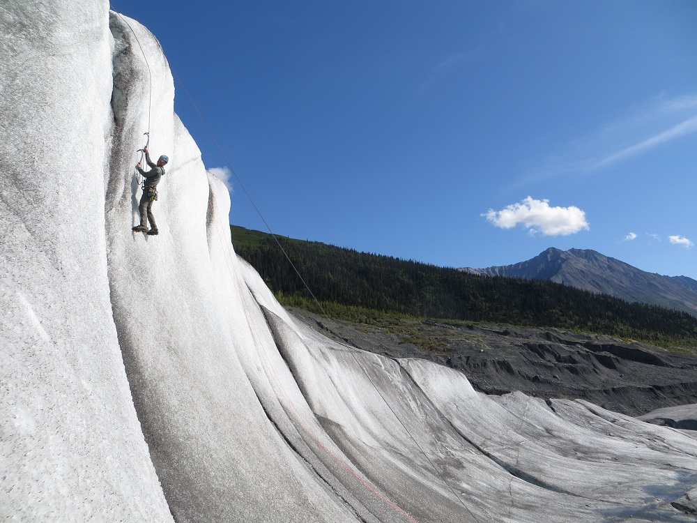 ice climber on glacier wall