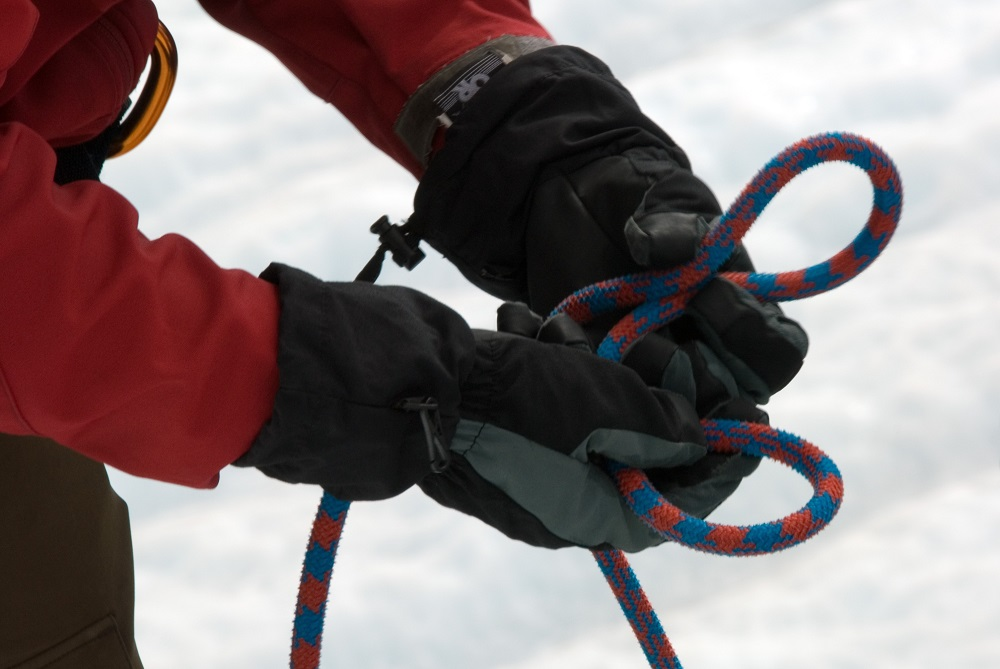 hands teaching climbing knot