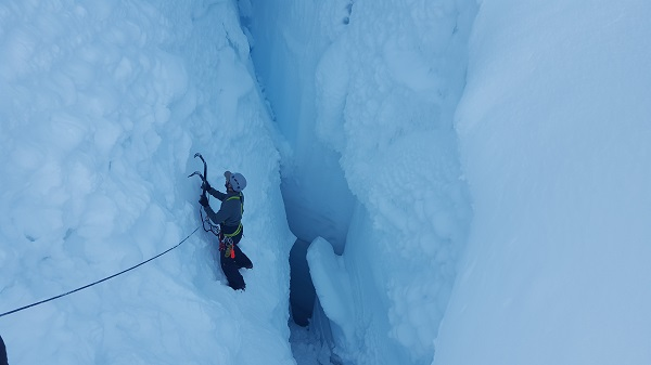 Sid ice climbing in a crevasse during a 10-day custom mountaineering course.