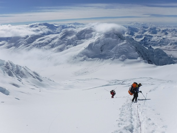 The Mt. Bona summit team descending down to base camp with clear skies and amazing views!