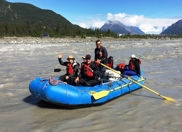 Jonny and his raft are full of smiles as they push off down the Kennicott River on our Three Rivers Rafting trip!