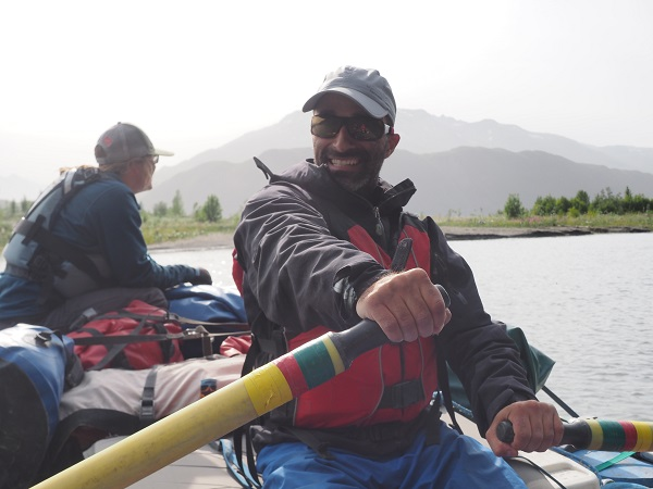 Fred, smiling as he enjoys some time on the oars on the Copper River!
