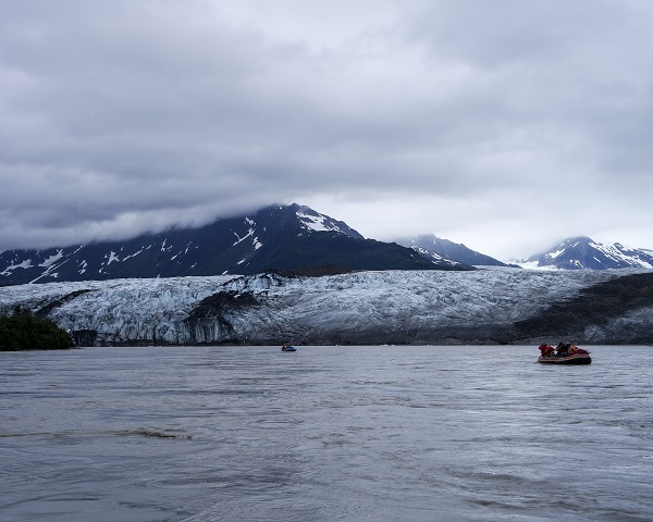 Rafting past the towering walls of the Child's Glacier on the Copper River.