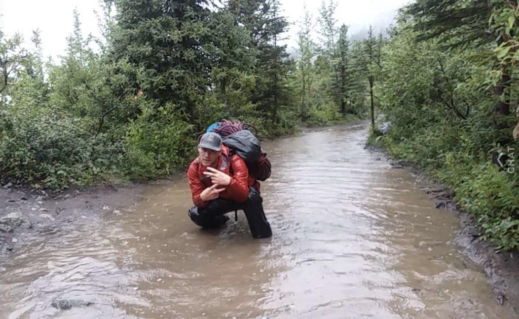 hiker in flood