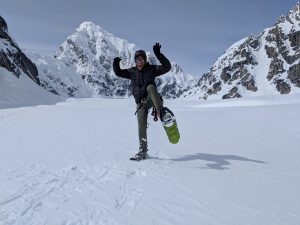 guide on snowshoes with mountains