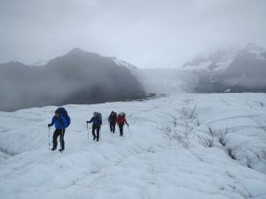 hikers on glacier