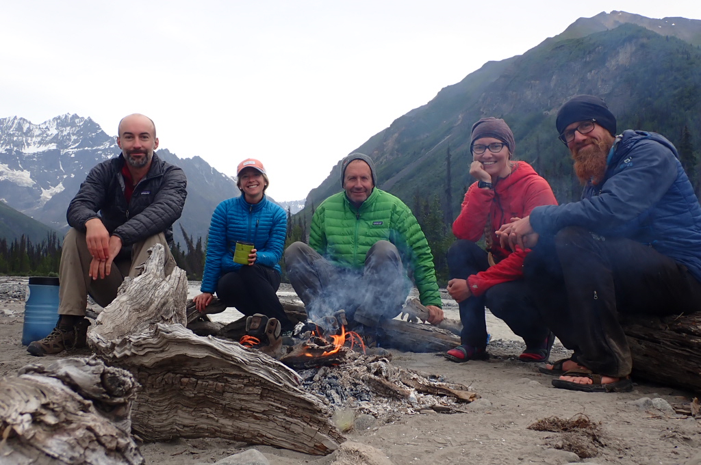 Hikers Around a Warm Fire