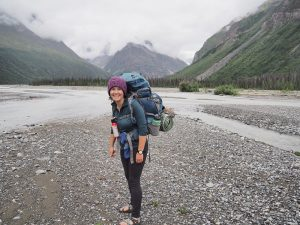 backpacker with river