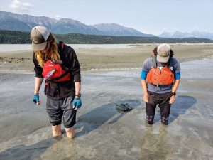 people standing in glacial mud